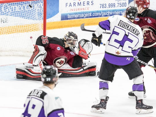 Shreveport Mudbugs forward Cole Quisenberry (22) tips home the game-winning goal during Monday's Robertson Cup Final vs. Minot.