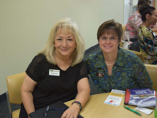 Dillie Nerios, left, Treasure Coast Food Bank; and