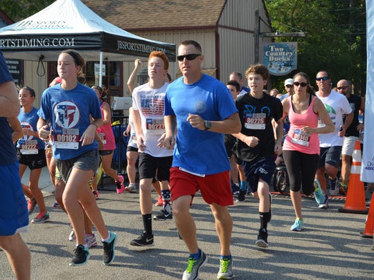 More than 200 people pre-registered for the 9/11 Heroes 5k run and 1-mile fun run that was held Saturday, Sept. 10 in the Historic Village of Smithville. Photo/Jodi Streahle