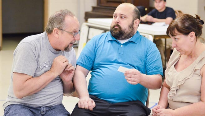 """Cast members (from left) Kiana Liesch as Kay Banks, Michael Horowitz as Mr. Banks and Deborah Oettinger as Mrs. Banks rehearse for Attic Theatre's production of """"Father of the Bride,"""" which opens Friday at the UW-Fox Valley Communication Arts Center in Menasha."""