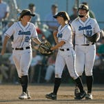 South Salem's Jessica Bohnstedt (from left), Kelly Burdick and Katie Donovan celebrate an out in the top of the seventh inning of the Saxons' 5-0 victory over Southridge in the quarterfinals at South Salem on Friday<137>, May 30, 2014<137>.