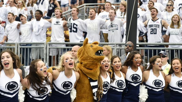 Cheerleaders stand with the Nittany Lion as they and the student section sing the alma mater after an NCAA Division I college football game Saturday, Sept. 17, 2016, at Penn State. Penn State defeated Temple 34-27, and celebrated the 50th anniversary of former head coach Joe Paterno's first game by honoring members of the 1966 football team and showing video tributes on the scoreboard.