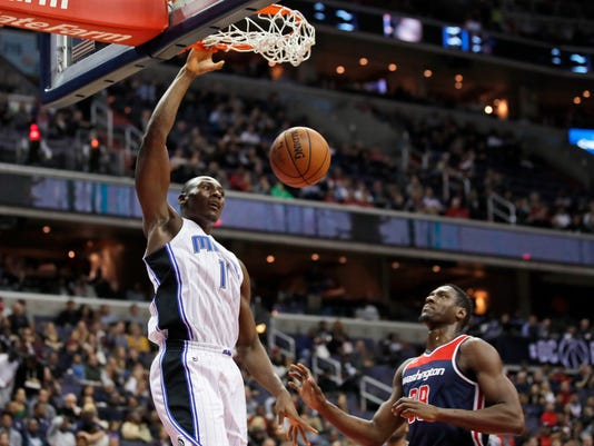 Orlando Magic forward Jonathan Isaac (1) dunks in front of Washington Wizards center Ian Mahinmi (28), from France, during the first half of an NBA basketball game Saturday, Dec. 23, 2017, in Washington. (AP Photo/Alex Brandon)