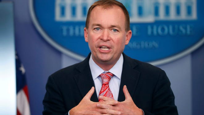 File photo shows federal Budget Director Mick Mulvaney, named by President Trump to serve simultaneously as acting director of the Consumer Financial Protection Bureau.