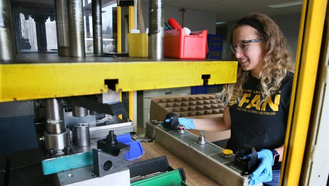 Jenna Backhaus works in an assembly area of Waukesha-based Wisconsin Metal Parts Inc. The fast-growing company is contending with a tight labor market as it hires people.