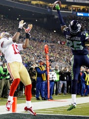 Richard Sherman made arguably the most important play in Seahawks history, tipping this pass away from 49ers receiver Michael Crabtree during the 2014 NFC Championship game in Seattle. Sherman will play for the 49ers next season.