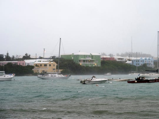 Heavy rain and increasing winds rock boats moored in Mullet Bay in St. Georges, Bermuda, Thursday, Oct. 13, 2016 as the island begins to feel the effects of Hurricane Nicole. The hurricane had strengthened to a Category 4 storm late Wednesday but lost some steam overnight. However, forecasters warned that it was still extremely dangerous.