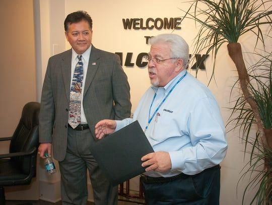 Las Cruces mayor Ken Miyagishima, left, and Calculex