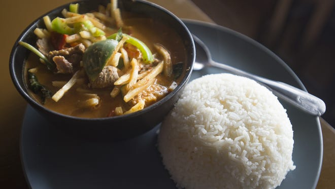 A red curry dish is served with a large helping of rice at Cafe de Bangkok on Friday, January 5, 2018. The popular Thai restaurant in Campus West has a selective hiring process to ensure cooks have proper training.