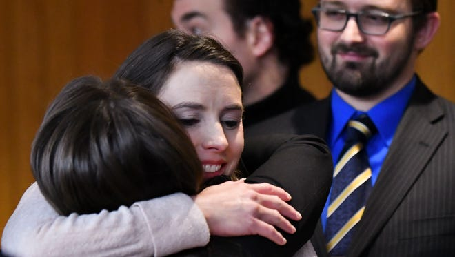 Rachael Denhollander hugs Det. Lt. Andrea Munford Monday, Feb. 5, 2018, after the third and final day of sentencing in Eaton County Court in Charlotte, Mich., where Nassar was sentenced on three counts of sexual assault.  [MATTHEW DAE SMITH/Lansing State Journal]