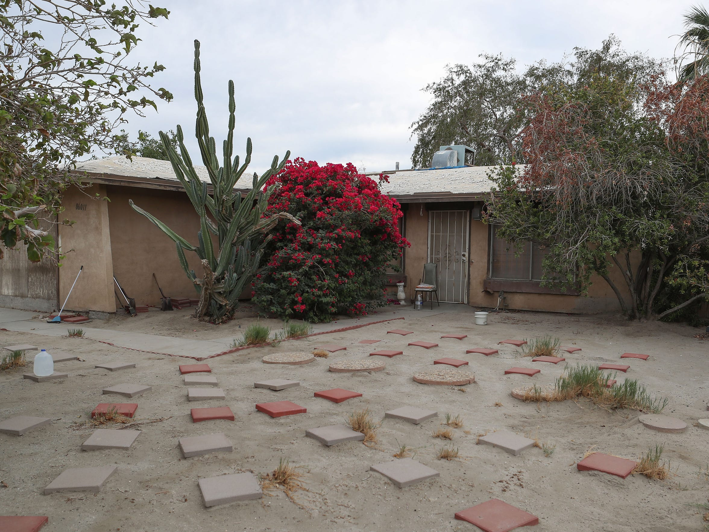 Coachella City Hall prosecuted the owner of this property because her yard was previously covered with broken appliances and overgrown vegetation. Now, city prosecutors have demanded the owner pay $25,200 for the cost of her own prosecution. If she doesn't pay, they may take her home.