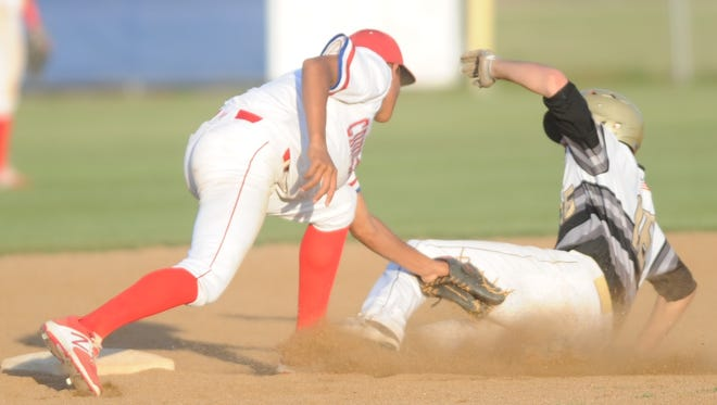 Cooper shortstop Shaun Watson, left, tags out Lubbock High's Joaquin Munoz for the third out in the top of the seventh. Munoz was trying to steal the base. Lubbock High won the game 13-5 Friday, April 21, 2017 at Cougar Field.