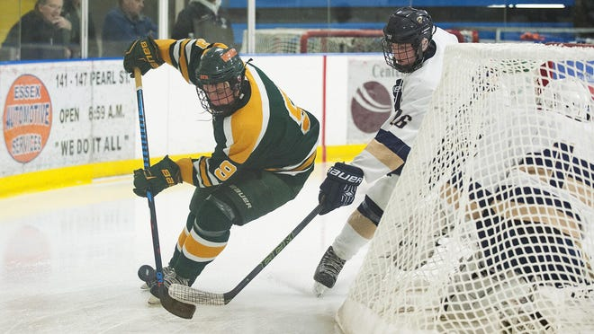 BFA-St. Albans' Ethan Bonnette (9) battles for the puck with Essex's Nathan Theriault (16) during the boys hockey game between the BFA-St. Albans Bobwhites and the Essex Hornets at the Essex Skating Facility on Wednesday night.