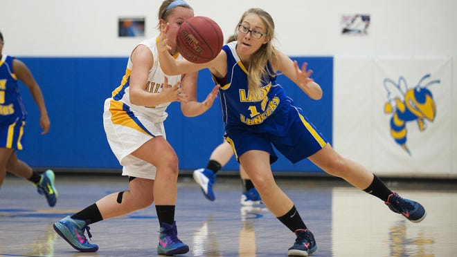 Lamoille's Katelin Collins (15) steals the ball from Milton's Megan Reilly (2) during the girls basketball game between Lamoille and Milton at Milton High School on Friday night.