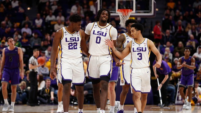 LSU forward Darius Days (22), forward Naz Reid (0) and guard Tremont Waters (3) celebrate after a basket during the Dec. 21 game against Furman in Baton Rouge.