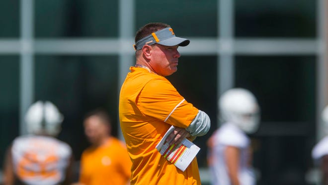 Head Coach Butch Jones surveys his players at the first University of Tennessee fall football practice of the year at Anderson Training Facility in Knoxville, Tenn. on Saturday, July 29, 2017.