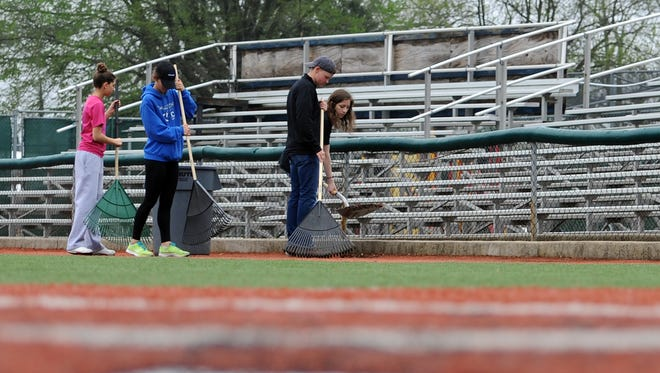 From left: Reeanna Houser, Jera Copley, Sean McCorkle and Jordan Wachovec rake up debris as part of United Way of Ross County's Day of Caring Thursday at VA Memorial Stadium.