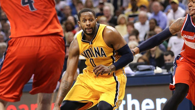Indiana Pacers guard C.J. Miles drives to the hoop through the Washington defense in overtime. The Pacers beat the Washington Wizards 99-95 in double overtime at Bankers Life Fieldhouse on Tuesday, April 14, 2015.