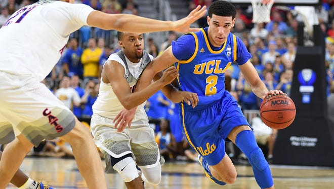 UCLA Bruins guard Lonzo Ball (2) dribbles past the defense of Arizona Wildcats guard Parker Jackson-Cartwright (0) during the Pac-12 Conference Tournament at T-Mobile Arena.