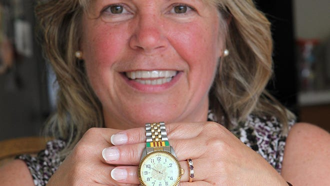 Kathy Campbell, of Hockessin, Del., holds a Vietnam veteran's watch she found on the side of the road in April. She is trying to find out the history of the watch and its possible owner.
