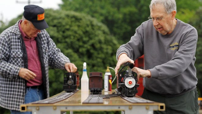 Charles Mote, right, and Bruce Gathman operate steam model trains during the Central Railroad Festival.