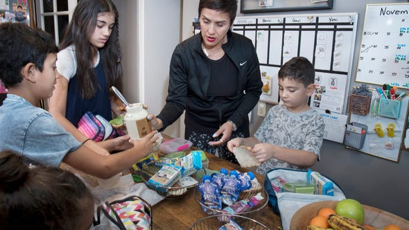 Lucia Schitzer makes school lunches with her kids,
