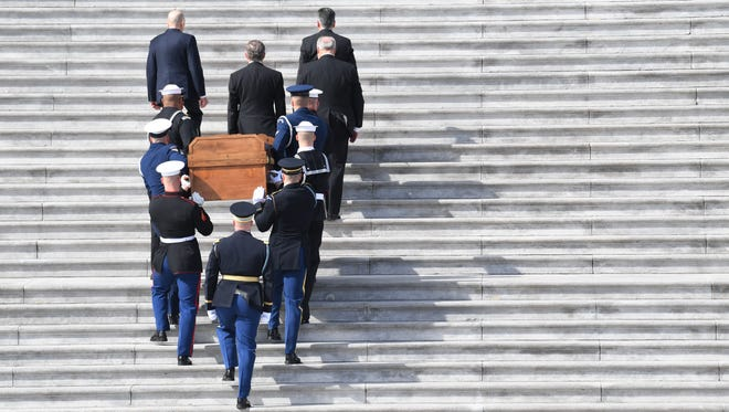 The body of evangelist Billy Graham is carried into the U.S. Capitol.