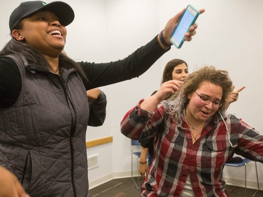Crew Scholars Haley Davis, left, and Olivia Berry sing and dance during a talent show in the Olmsted Center at Drake University in Des Moines, Thursday, March 24, 2016. The Crew Scholars Program offers academic, social and financial support to students of color as they navigate college life.