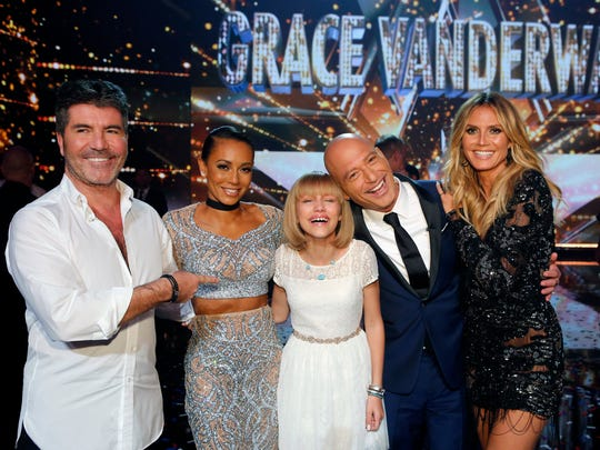 Suffern singer Grace VanderWaal with, (l-r) Simon Cowell, Mel B,  Howie Mandel, Heidi Klum. VanderWaal has signed a record deal with Cowell's Syco Records.