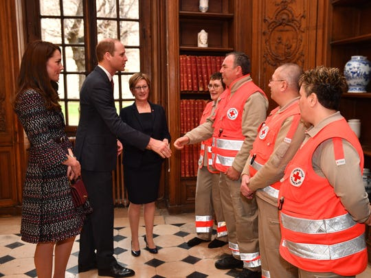 Prince William shakes hands with the first responders