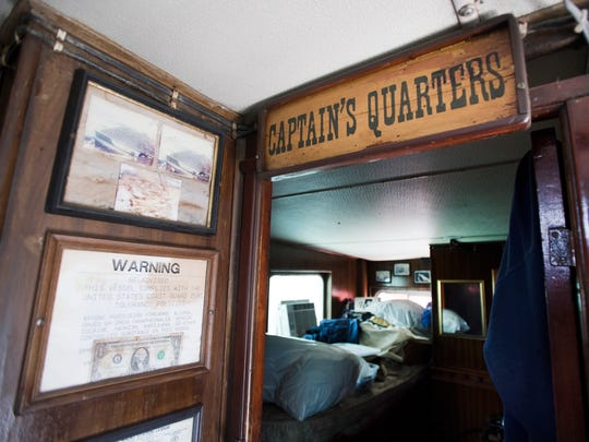 The first dollar that Wayne Magwood made on his boat, Winds of Fortune, is framed in the living quarters of his boat on Shem Creek in Mount Pleasant on Tuesday, April 11, 2017.