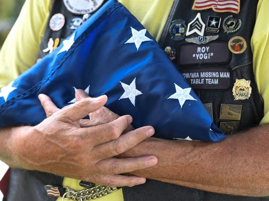 Rolling Thunder member Roy Holder holds a folded American Flag during a presentation at the Ark Crisis Care Center in Evansville Monday, July 3, 2017.