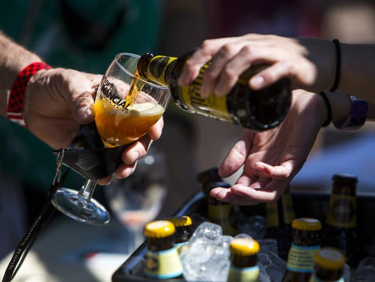 A beer sample is poured during the Devour Culinary