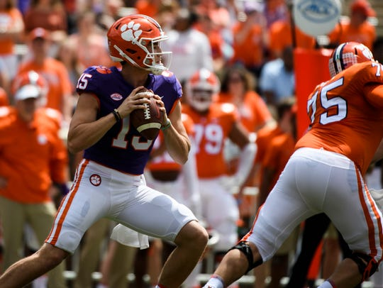 Clemson quarterback Hunter Johnson (15) searches for