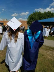 Gabby Satryb and Phillip Griffor show off their red hearts at Marysville High School's graduation ceremony in June.