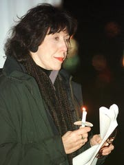 Actress Lily Tomlin attends a candlelight vigil in commemoration of World AIDS Day at the First Congregational Church in Burlington in 1999. Tomlin, who was in town performing at the Flynn Theatre, urged people who were gathered to not let up the fight against the disease.