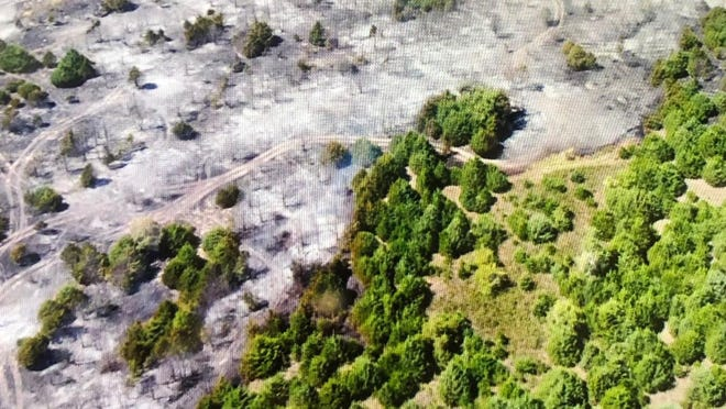 FIre damaged about 60 acres of land between Halstead and Burrton on Thursday.