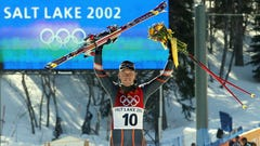 FILE - In this Feb. 10, 2002, file photo, Austria's Fritz Strobl celebrates during the flower ceremony after winning the gold medal in the Salt Lake City Winter Olympic Games Men's Downhill in Snowbasin, Utah. Salt Lake City got the green light to bid for an upcoming Winter Olympics most likely for 2030 in an attempt to bring the Games back to the city that hosted in 2002 and provided the backdrop for the U.S. winter team's ascendance into an international powerhouse. (AP Photo/Rudi Blaha, File )