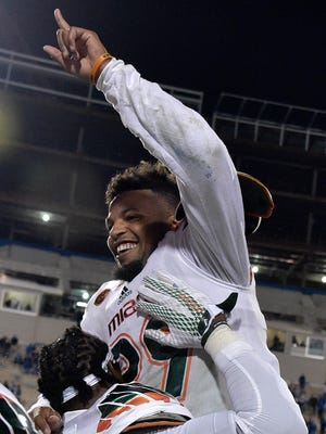 Miami's Corn Elder celebrates one of the greatest finishes in Hurricanes football history on Saturday night.