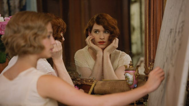 Alicia Vikander (foreground) and Eddie Redmayne star in 'The Danish Girl.'