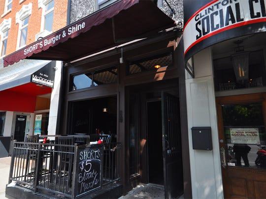 Shorts Burer & Shine and the Clinton Street Social Club line Clinton Street in Iowa City.