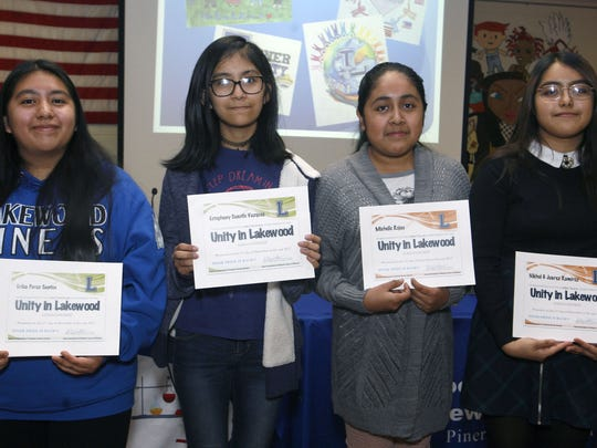 Winners of the Lakewood public schools unity art project are left to right, high school 2nd place Erika Perez Santos, 14, middle school 2nd place Estephany Cuautle Vazquez, 12,  middle school 1st place Michelle Rojas, 12. and high school first place Nikhol G. Juarez Ramirez, 14 at Lakewood High School December 11, 2017.