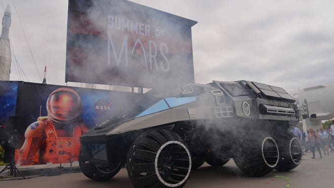 """Kennedy Space Center Visitor Complex kicked off the """"summer of Mars' with an appearance of retired astronaut Scott Kelly.  Kelly completed four space flights and served as commander aboard the International Space Station on three expeditions. In 2015, Kelly began a nearly yearlong mission aboard the International Space Station. After his talk there was the unveiling of the Mars Rover mockup."""