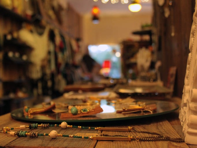 Handmade jewelry, much of it by local artists, adorns