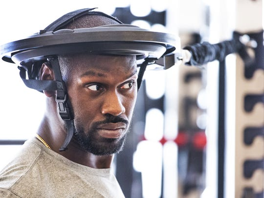The Arizona Cardinals began their offseason strength and conditioning program at the practice facility in Tempe, Tuesday, April 9, 2019.  Linebacker Chandler Jones wears the Iron Neck strengthening headgear during workouts.