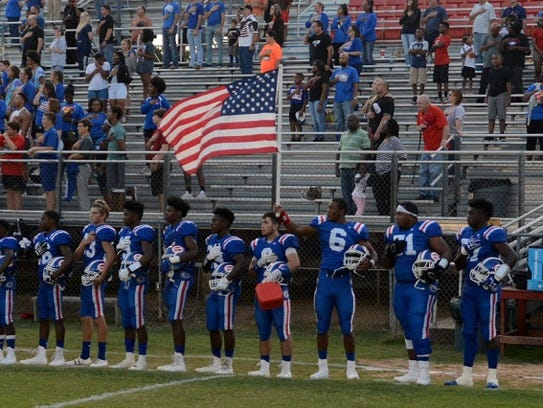 The Evangel football team shows its patriotism prior