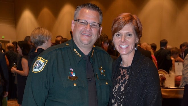 Sheriff Wayne Ivey and his wife Susan attended the Health First Foundation's Grape Escape  fundraiser in 2013. At this year's event, the Iveys will serve as auctioneers.