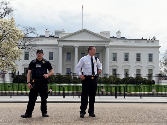 Members of the Secret Service stand on Pennsylvania