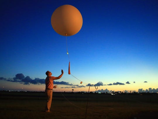 Meteorologist Kevin Wagner releases a weather balloon that collects data Monday, June 12, 2017, at the National Weather Service in Corpus Christi.