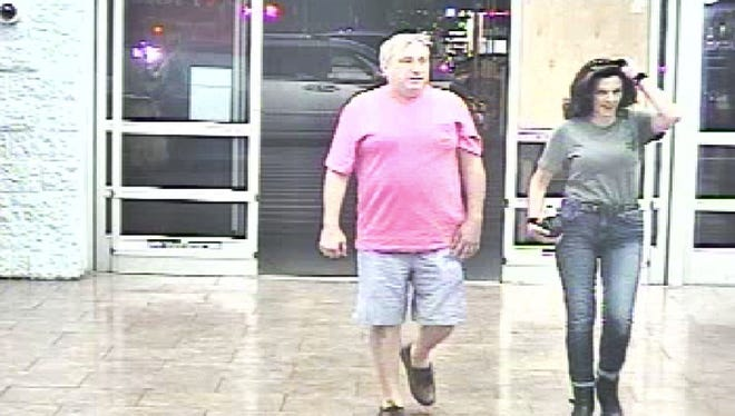 Paul Tucci and Laura Rideout enter the Hudson Avenue Walmart.
